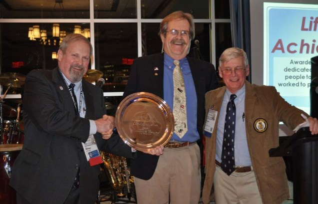 Lifetime Achievement award winner Capt. Jan Miles (center) with M. Rauworth and Dave Wood