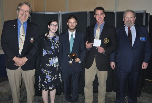 Crew from Pride of Baltimore II accepts the award. From L to R - Captain Jan Miles, Eliza Braunstein, Will McLean, Captain Jamie Trost (holding a copy of the winning crew list) and Michael Rauworth, Chairman of Tall Ships America