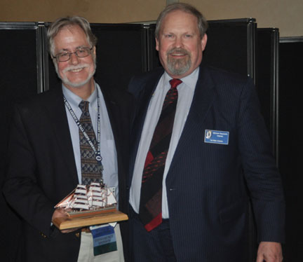 Executive Director of San Diego Maritime Museum, Raymond Ashley, accepts the award for Sea Education Program from Michael Rauworth