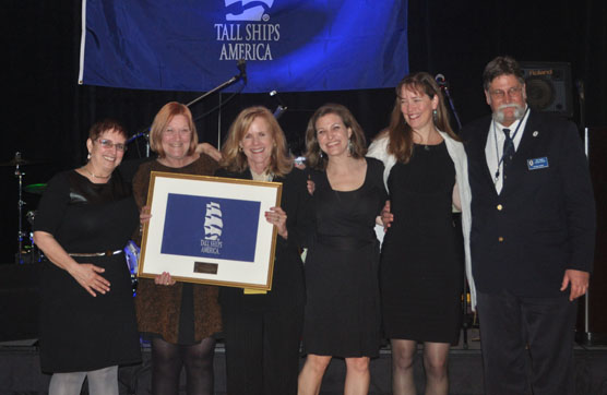 Members of the Tall Ships America staff present Patti Lock with a Special Recognition award.
