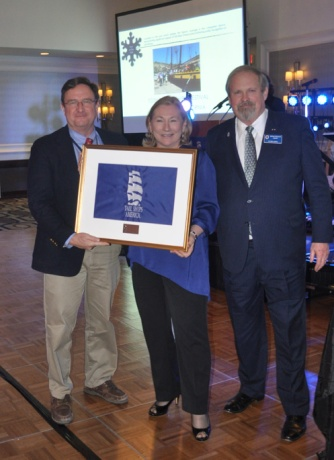 Shirley Roberts (c), 2013 Port of the Year winner for Bay City, MI, awards TSC 2015 Port of the Year to Dana Point, accepting on behalf of the port is CAPT Eric Shaw (r). On the left is Tall Ships America Chairman of the Board, Mike Rauworth
